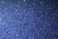 Crystal shining sugar sand of blue color used for decorating pastries and cakes macro background royalty free stock images