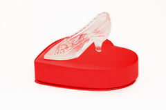 Crystal shoe on a red gift box in heart shape. Isolated Royalty Free Stock Photography