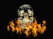 Crystal skull surrounded by fire Royalty Free Stock Images