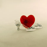 Crystal Slipper and heart. Crystal Slipper representing fashion and cinderella-like fantasies with a heart for love Stock Photos