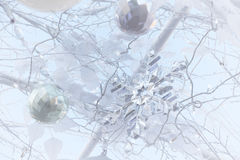 Crystal snow flake and all decoration on white Christmas tree. Royalty Free Stock Image
