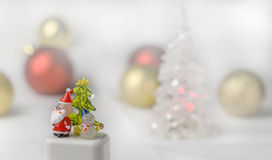 Crystal Snow man and Santa Claus with christmas ball background Stock Image