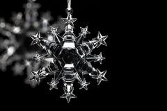 Crystal snowflake on black background Stock Photography