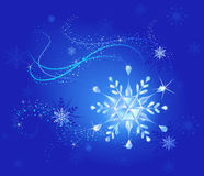 Crystal snowflake on a blue Royalty Free Stock Photos
