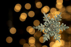 Crystal Snowflake on Gold Background Royalty Free Stock Photo