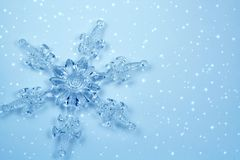 Crystal snowflake in snow Royalty Free Stock Photos