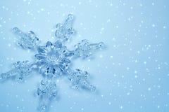 Crystal snowflake in snow. Christmas decoration - Crystal snowflake in snow. Background for card Royalty Free Stock Photos