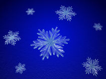 Crystal snowflakes in blue Stock Photos