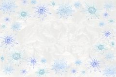 Crystal snowflakes on icy background. Vintage chandelier crystals & bobeches as snowflakes on jack frost icy wintry background Royalty Free Stock Photography