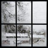 Crystal snowflakes on icy window stock photos