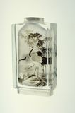 Crystal snuff bottle with  miniature painting of cranes inside Stock Image