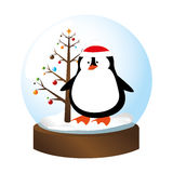 Crystal sphere with christmas tree and penguin inside Stock Photography