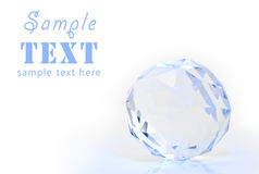 Crystal sphere with a facet. On a white background stock photo