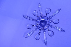 Crystal star, snowflake. Vintage crystal chandelier prisms in star, snowflake pattern Stock Photography