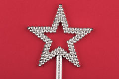 Crystal star wand on red background Stock Images