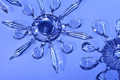 Crystal stars, snowflakes. Vintage crystal chandelier prisms in star, snowflake patterns Royalty Free Stock Image