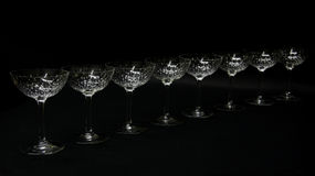 Crystal stemware. A black background with crystal stemware Royalty Free Stock Photos