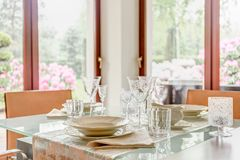 Crystal stemware and porcelain tableware Royalty Free Stock Photography