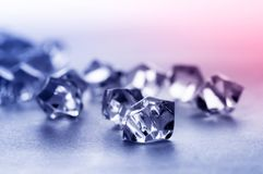 Crystal stone. On a colored background Stock Photos
