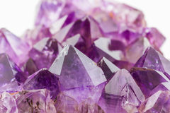 Crystal Stone, purple rough amethyst crystals. Royalty Free Stock Images