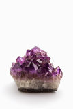 Crystal Stone, purple rough amethyst crystals. Royalty Free Stock Photos