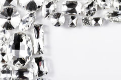 Crystal strasses. Large crystal strasses on a white background - macro photo Stock Photos