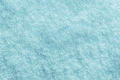 Crystal texture winter snow cover of turquoise color Royalty Free Stock Image