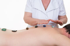 Crystal therapy, man is having stone massage. Crystal therapy, men having stone massage Stock Images