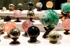 Crystal therapy spheres. Many crystal therapy spheres on a market stall during a wellness exhibition stock photography