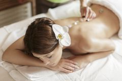 Crystal therapy. Young woman having a crystal therapy Royalty Free Stock Images