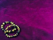 Free Crystal. Tiger`s Eye Bracelet , Two Bracelet On Purple Violet Velvet Background. Stock Photography - 166459022