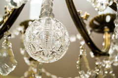 Crystal transparent decorations of a chandelier Stock Photos