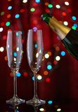 Crystal two glasses and open bottle of champagne on festive back Stock Image
