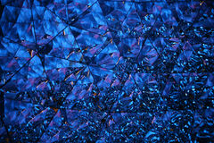 Crystal universe in blue. Abstract image of some facets of a crystal with refraction Royalty Free Stock Image