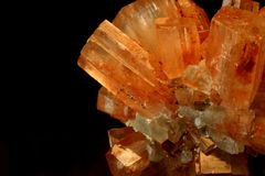Crystal up close. A close up of a piece red and orange crystal isolated on black Royalty Free Stock Photography