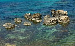 Crystal water in mediterranean sea,turquoise water on summertime in Malta,crystal sea and rocks, maltese nature. Malta, Europe, calm summer day, calm sea, calm Stock Image