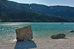 Crystal water at midday in Molveno. Stock Images