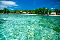 Crystal water with the view on the beach with bungalows Sumatra, Indonesia. Crystal clear water with the view on the beach with bungalows Sumatra, Indonesia royalty free stock images
