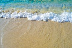 Crystal waves washing over the shoreline. Beautiful beach front with waves crashing on the shoreline with clear and crystal body of water and foamy waves and Royalty Free Stock Photography