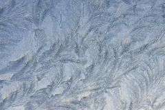 Ice mosaic. Crystal white frost pattern on a cold morning glass royalty free stock image