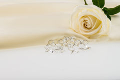 Crystal, white rose on ivory silk satin Royalty Free Stock Images