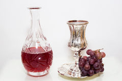 Crystal Wine bottle and a glass with grapes. Stock Photos