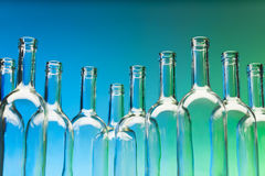 Crystal wine bottles standing in a row Stock Photo