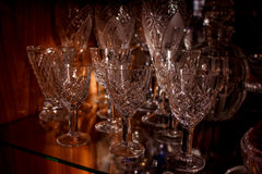 Crystal wine glasses. On a glass shelf Stock Images