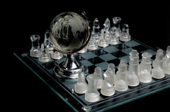 Crystal world chess globe. Crystal chess pieces with a globe in the center.On black background.south and north America seen on the globe Stock Photos