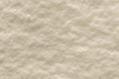 Crystal yttersida av beige snö Arkivbild