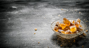 Crystalline cane sugar in a saucer. Stock Image