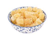 Crystallised stem ginger in a blue and white china bowl Stock Image