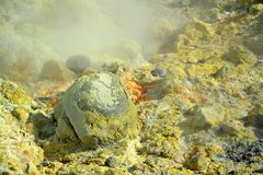 Crystallization of minerals. The surface of the active sea volcano is formed by crystallizing minerals, especially sulfur. The surface has a distinctive volcanic Royalty Free Stock Image