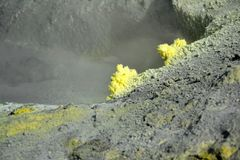Crystallization of minerals. The surface of the active sea volcano is formed by crystallizing minerals, especially sulfur. The surface has a distinctive volcanic Stock Photos